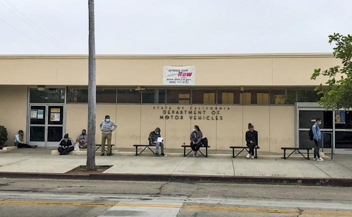 "People without appointments wait in line for the Hollywood DMV field office to open on July 16. <span class=""copyright"">(Adam Tschorn / Los Angeles Times)</span>"