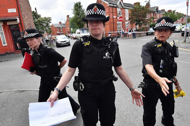 <p>Police put up a corden as they attend the scene of a raid in the Moss Side area as part of their ongoing investigation following the terror attack earlier this week on May 27, 2017 in Manchester, England. The Manchester Arena suicide bombing killed 22 people on the evening of May 22 as concert goers were leaving the venue after an Ariana Grande performance. (Photo: Anthony Devlin/Getty Images) </p>