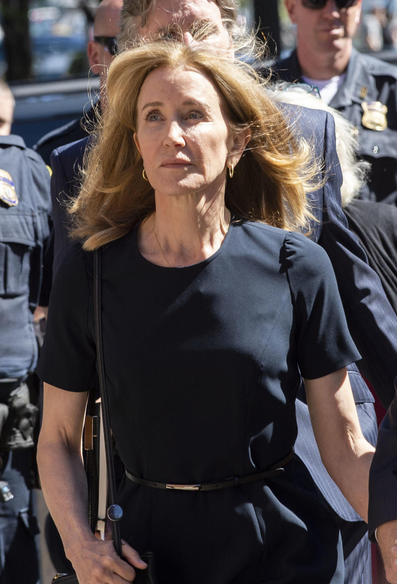 Actress Felicity Huffman makes her way to the entrance of the John Joseph Moakley United States Courthouse September 13, 2019 in Boston, where she will be sentenced for her role in the College Admissions scandal. - Huffman, one of the defendants charged in the college admissions cheating scandal, is scheduled to be sentenced for paying $  15,000 to inflate her daughters SAT scores, a crime she said she committed trying to be a good parent. (Photo by Joseph Prezioso / AFP) (Photo credit should read JOSEPH PREZIOSO/AFP/Getty Images)