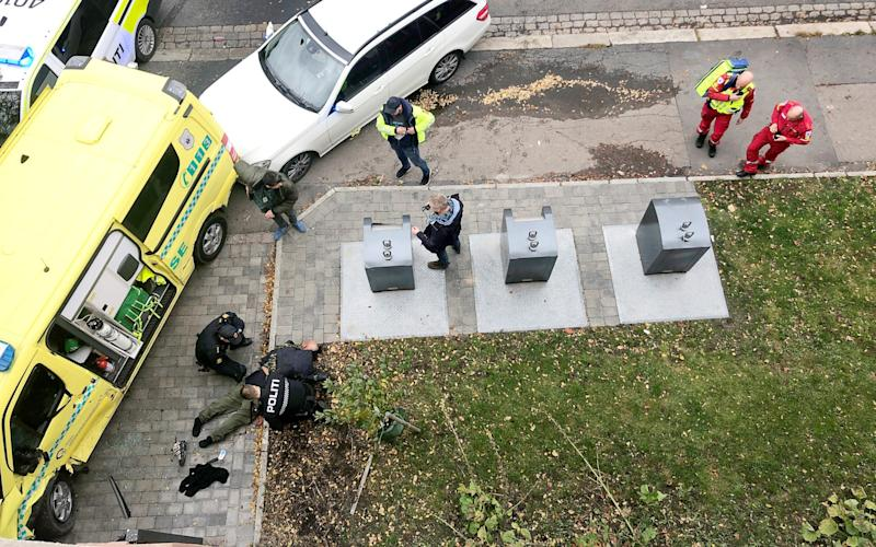 Police officers apprehend the armed man who stole an ambulance - via REUTERS