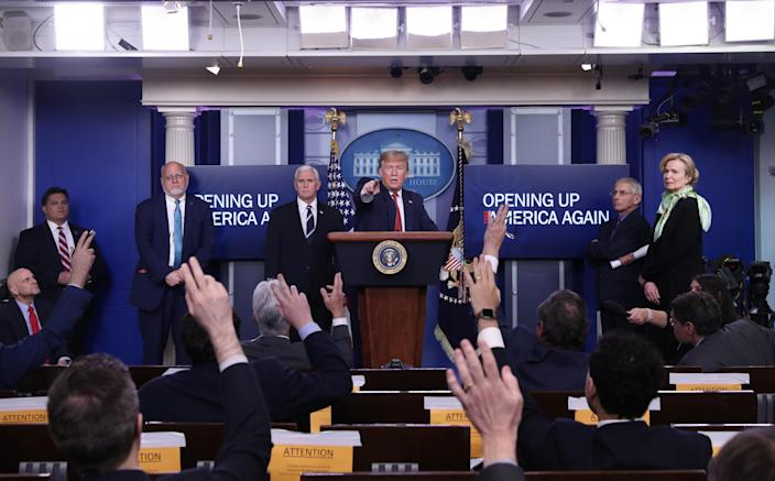 """President Trump during the announcement last week of his administration's guidelines for """"Opening Up America Again."""" (Leah Millis/Reuters)"""