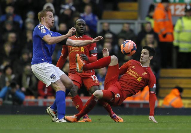 Oldham Athletic's Adam Rooney (L) challenges Liverpool's Luis Alberto during their FA Cup third round soccer match at Anfield in Liverpool January 5, 2014. REUTERS/Phil Noble (BRITAIN - Tags: SPORT SOCCER)
