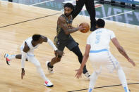 Chicago Bulls guard Coby White, center, looks to pass the ball as Los Angeles Lakers guard Dennis Schroeder, left, and forward Anthony Davis defend during the first half of an NBA basketball game in Chicago, Saturday, Jan. 23, 2021. (AP Photo/Nam Y. Huh)