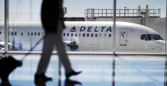 a Delta Air Lines jet sits at a gate at Hartsfield-Jackson Atlanta International Airport in Atlanta. (AP)