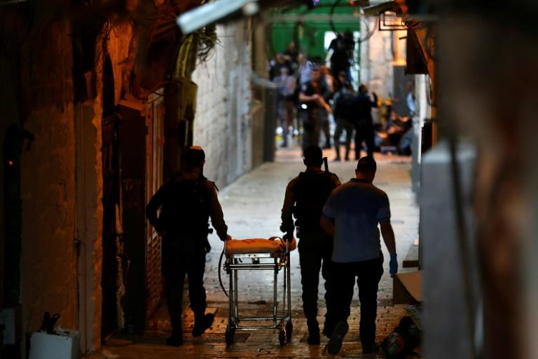 Israeli security forces gather at the site of a reported stabbing attack at one of the entrances of Al-Aqsa Mosque compound in the Old City of annexed east Jerusalem