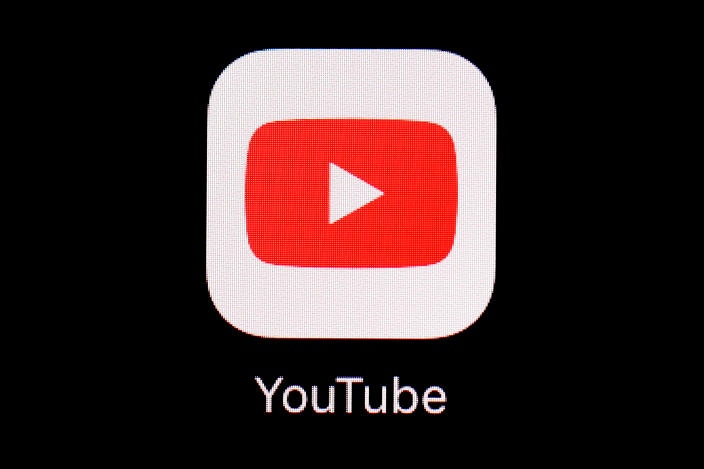 FILE - This March 20, 2018, file photo shows the YouTube app on an iPad in Baltimore. YouTube on Friday, March 5, 2021, said it has removed five channels run by Myanmar's military for violating its community guidelines and terms of service. (AP Photo/Patrick Semansky, File)