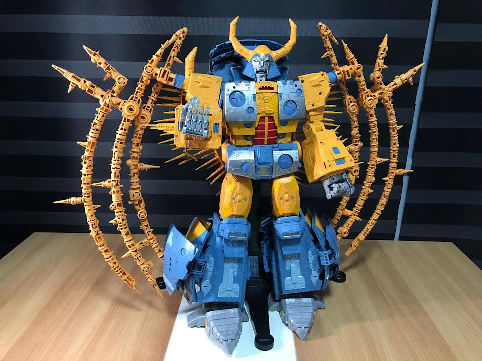 Unicron and a 10-cent coin.