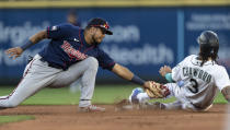 Minnesota Twins second baseman Luis Arraez tags out Seattle Mariners' J.P. Crawford on an attempted steal of second base during the fourth inning of a baseball game Wednesday, June 16, 2021, in Seattle. Crawford was originally called safe, but after a challenge he was ruled out. (AP Photo/Stephen Brashear)