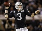 Oakland Raiders quarterback Carson Palmer drops back to throw during the first quarter of an NFL football game against the Denver Broncos in Oakland, Calif., Thursday, Dec. 6, 2012. (AP Photo/Marcio Jose Sanchez)