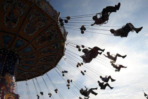 Visitors ride a chairoplane at the Theresienwiese Oktoberfest fair grounds in Munich, Germany. With about eight million beers downed each year at the Oktoberfest, you might expect a few items to go awry, but the lost-and-found office at the world's top beer fest really has seen it all