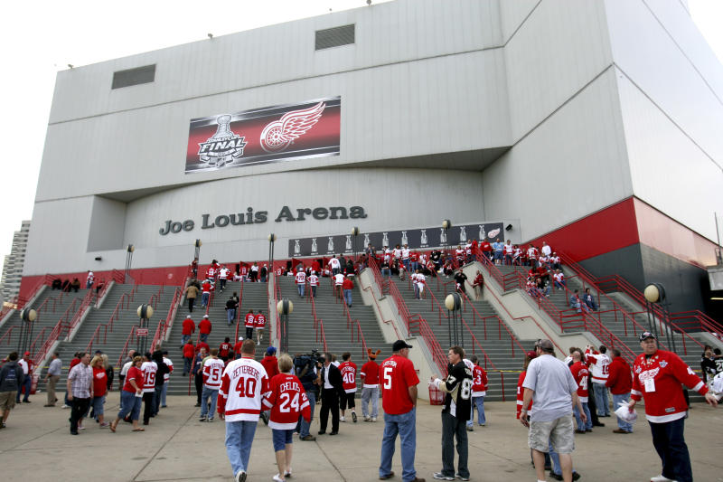 FILE - In this May 31, 2009, file photo, hockey fans enter Joe Louis Arena for Game 2 of the NHL Stanley Cup Finals hockey series in Detroit. The Lions, Tigers and Red Wings have had little trouble drawing fans despite the economic downturn in Detroit, so don't expect those franchises to crumble in light of the city's bankruptcy filing. But there are questions to answer, especially for the Red Wings, who are hoping to move from Joe Louis Arena into a new downtown facility that team and city officials announced plans for last month. (AP Photo/Carlos Osorio, File)