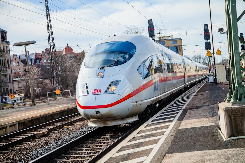 Fuerth / Germany - March 11, 2018: ICE 3, intercity-Express train from Deutsche Bahn passes train station fuerth in germany.