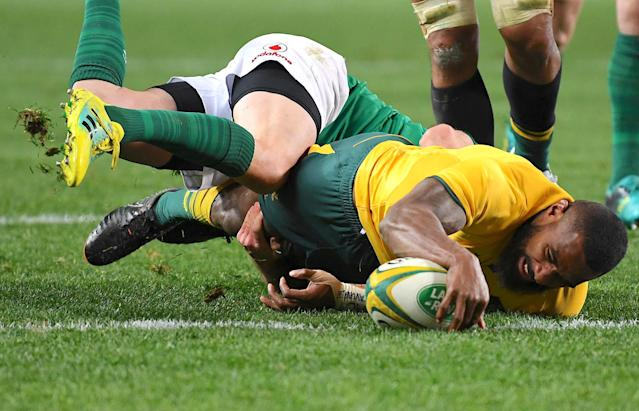 Rugby Union - June Internationals - Australia vs Ireland - Sydney Football Stadium, Sydney, Australia - June 23, 2018 - Australia's Marika Koroibete stretches to score a try. AAP/David Moir/via REUTERS ATTENTION EDITORS - THIS IMAGE WAS PROVIDED BY A THIRD PARTY. NO RESALES. NO ARCHIVE. AUSTRALIA OUT. NEW ZEALAND OUT.