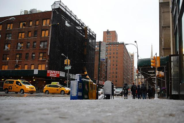 <p>The mixture of rain and snow make conditions slippery on roads and sidewalks in New York City on March 7, 2018. (Photo: Gordon Donovan/Yahoo News) </p>