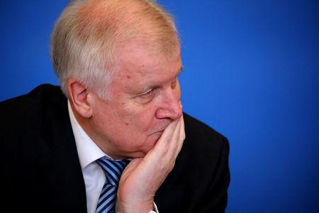 "FILE PHOTO: German Interior Minister Horst Seehofer presents his ""Migrant Masterplan"" in Berlin, Germany, July 10, 2018.      REUTERS/Hannibal Hanschke/File Photo"