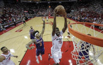 Houston Rockets' Clint Capela (15) goes up to dunk the ball as Phoenix Suns' Kelly Oubre Jr. (3) defends during the second half of an NBA basketball game Saturday, Dec. 7, 2019, in Houston. The Rockets won 115-109. (AP Photo/David J. Phillip)