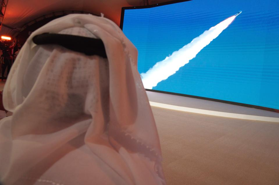 "An Emirati man watches the launch of the ""Amal"" or ""Hope"" space probe at the Mohammed bin Rashid Space Center in Dubai, United Arab Emirates, Monday, July 20, 2020. A United Arab Emirates spacecraft, the ""Amal"" or ""Hope"" probe, blasted off to Mars from Japan early Monday, starting the Arab world's first interplanetary trip. (AP Photo/Jon Gambrell)"
