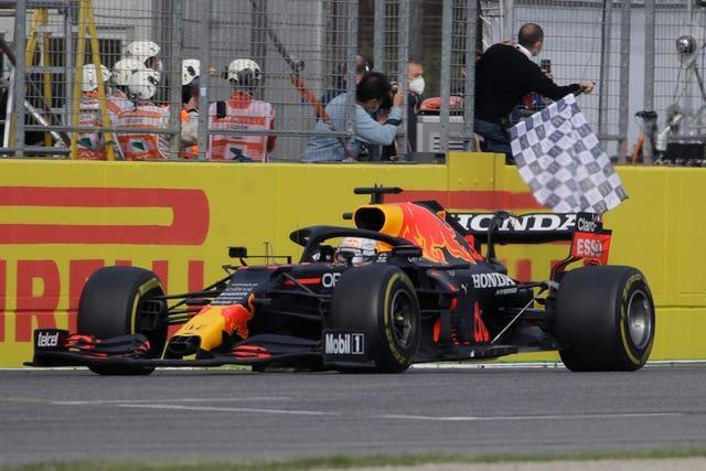 Red Bull's Max Verstappen was triumphant in an incident-packed Emilia-Romagna Grand Prix