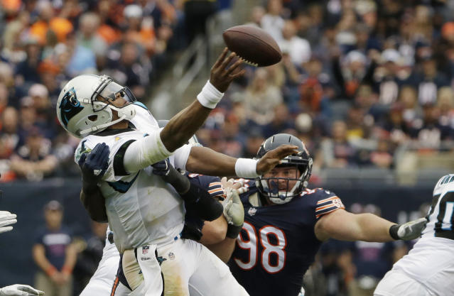 <p>Carolina Panthers quarterback Cam Newton throws the ball under pressure during the second half of an NFL football game against the Chicago Bears, Sunday, Oct. 22, 2017, in Chicago. (AP Photo/Nam Y. Huh) </p>