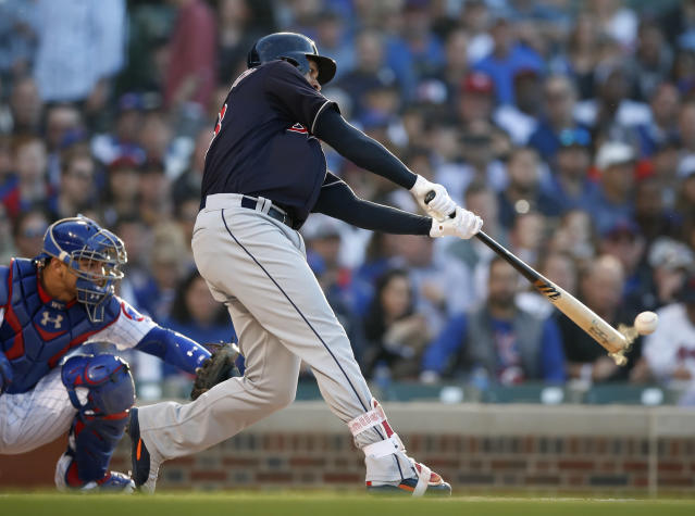 Cleveland Indians' Michael Brantley hits a single during the first inning of the team's baseball game against the Chicago Cubs on Wednesday, May 23, 2018, in Chicago. (AP Photo/Jim Young)