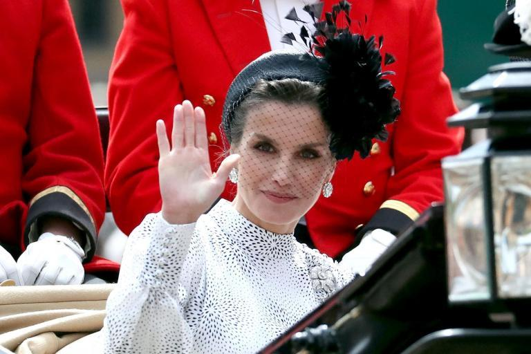 Queen Letizia has often been called Spain's answer to Kate Middleton. And like Kate Middleton, she prefers to mix affordable high street pieces with designer buys. She was most recently snapped alongside the Duchess of Cambridge at the Order of the Garter service and parade in Cambridge, where the women leaned into their lookalike style by coordinating in black and white outfits.Queen Letizia wore Spanish brand Cherubina, embracing spring's puff sleeve trend in a thoroughly modern way. Both ladies even accessorized in black, opting for black heels and fascinators. The other Royals present, including Sophie, Countess of Wessex, the Duchess of Cornwall and the Netherlands' Queen Maxima all wore different shades of millennial pink. In the past, she's opted for a leather dress from & Other Stories as well as an elegant Asos dress with delicate floral embroidery that was under $100 (it's out of stock but the brand offers similar options). She showed off a similarly glam red maxi dress from Asos in Madrid, which was previously on sale for only $69. She's also a fan of the approachable French brand Sandro, which Princess Eugenie has named as a favorite. Queen Letizia most often faces comparisons to the Duchess of Cambridge, but much like Meghan Markle, she had a successful career before she married into the Royal Family in 2004. She worked as a journalist before she married King Felipe in an elaborate ceremony at the Royal Palace in Madrid. And like Markle, she was previously married - but still had a fairy tale-worthy Royal wedding She previously worked for news channels including CNN+ and 24 Horas. She reported from Ground Zero in New York City after 9/11. She met her husband at a dinner party arranged by fellow journalists in 2002. They announced their engagement in 2003, surprising the country as they had kept their relationship under wraps. Queen Letizia is notable for mixing high and low designers, as well as giving Spanish brands their time to shine. Her wedding gow