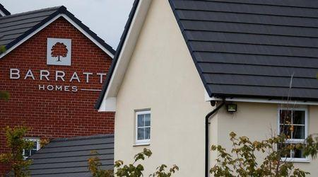 A company logo is seen on the side of a house at a Barratt Homes housing development near Preston