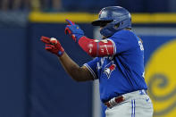 Toronto Blue Jays' Vladimir Guerrero Jr. celebrates his double off Tampa Bay Rays' Drew Rasmussen during the fourth inning of a baseball game Tuesday, Sept. 21, 2021, in St. Petersburg, Fla. (AP Photo/Chris O'Meara)
