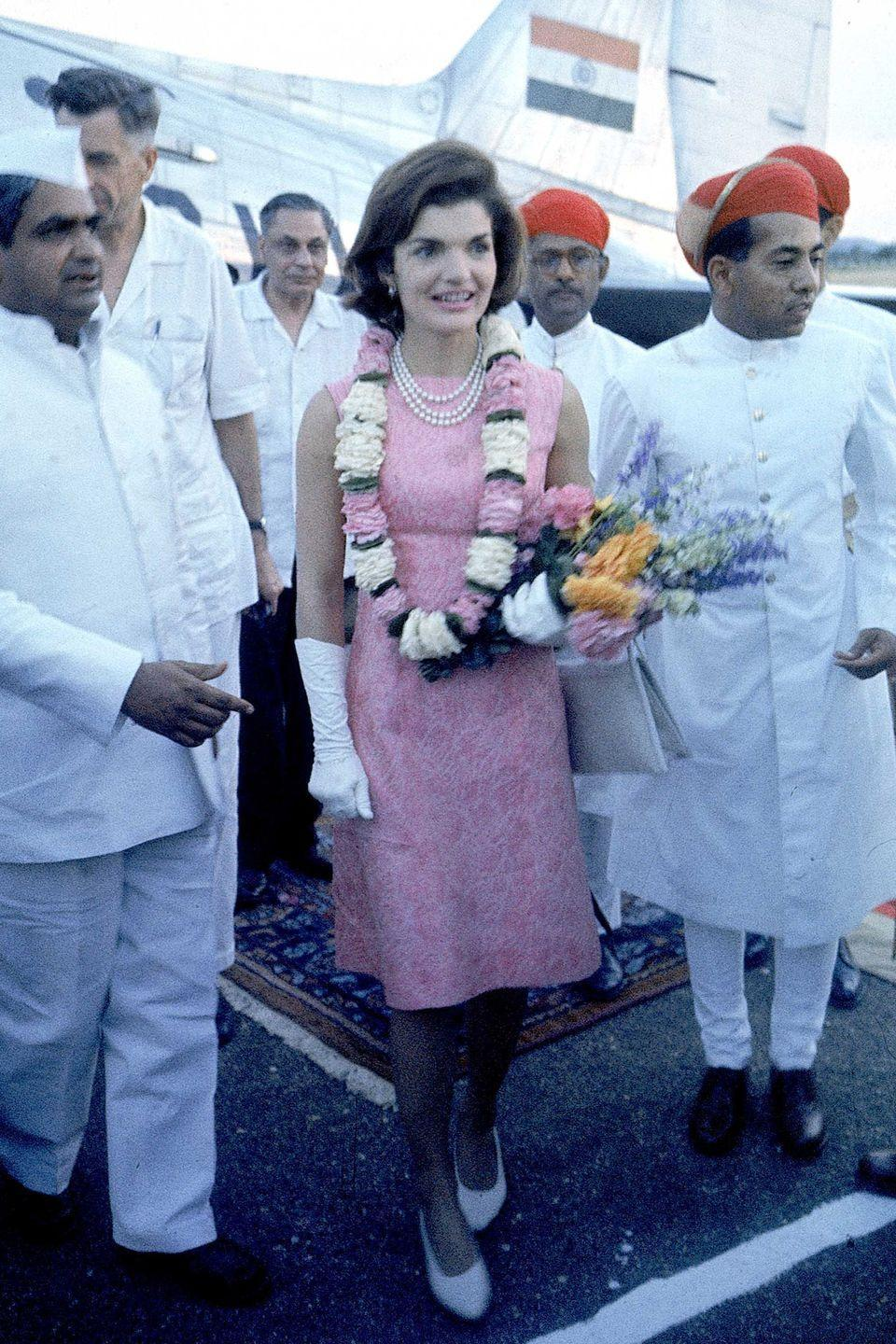 <p>While her pink Chanel suit will go down in infamy, this little shift was worn during happier times. White gloves, pearls and pumps finish the idea.</p>