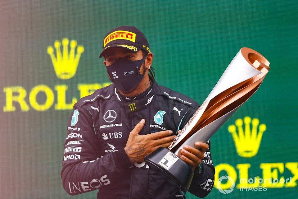 "Race Winner Lewis Hamilton, Mercedes-AMG F1 celebrates on the podium with the trophy<span class=""copyright"">Andy Hone / Motorsport Images</span>"