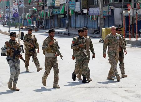 Afghan security forces arrive at the side of a blast in Jalalabad, Afghanistan