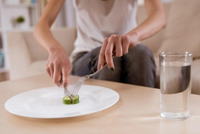 """<span class=""""caption"""">Eating disorders are very hard to treat, and those who have them often severely limit their food intake. </span> <span class=""""attribution""""><a class=""""link rapid-noclick-resp"""" href=""""https://www.shutterstock.com/image-photo/thin-girl-sitting-on-sofa-empty-367721750?src=DNymoX69upd5ZTL3kiSrpw-1-51"""" rel=""""nofollow noopener"""" target=""""_blank"""" data-ylk=""""slk:VGstockstudio/Shutterstock.com"""">VGstockstudio/Shutterstock.com </a></span>"""