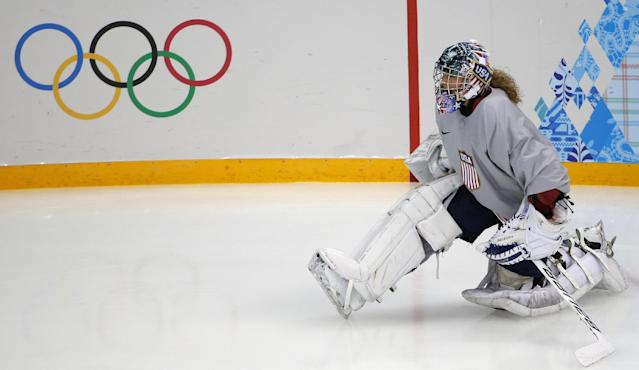 Jessie Vetter goalkeeper of the U.S. women's ice hockey team stretches during a practice session ahead of the 2014 Winter Olympics, Friday, Feb. 7, 2014, in Sochi, Russia. (AP Photo/Petr David Josek)