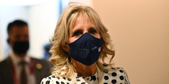 First lady of the United States Jill Biden arrives for the opening ceremony in the Olympic Stadium at the 2020 Summer Olympics, Friday, July 23, 2021, in Tokyo, Japan.