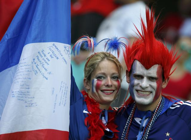 France fans wait for the start of the 2014 World Cup Group E soccer match between Switzerland and France at the Fonte Nova arena in Salvador June 20, 2014. REUTERS/Jorge Silva (BRAZIL - Tags: SOCCER SPORT WORLD CUP)