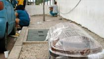 A coffin wrapped in plastic is seen outside a hospital in Guayaquil on April 1 (AFP Photo/Enrique Ortiz)