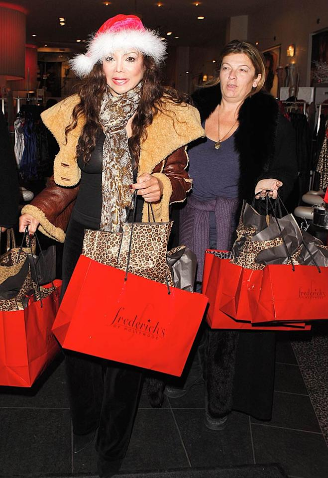 """La Toya gets into the holiday spirit by donning a Santa cap as she makes her way out of Frederick's. How festive! Maciel/<a href=""""http://www.x17online.com"""" target=""""new"""">X17 Online</a> - December 16, 2009"""