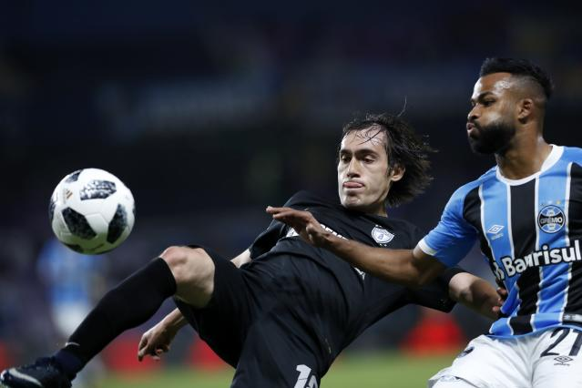 Brazil's Gremio Fernandinho, right, and Mexico's Pachuca Joaquin Martinez fight for the ball during the Club World Cup semifinal soccer match between Gremio and Pachuca at the Hazza Bin Zayed stadium in Al Ain, United Arab Emirates, Tuesday, Dec. 12, 2017. (AP Photo/Hassan Ammar)