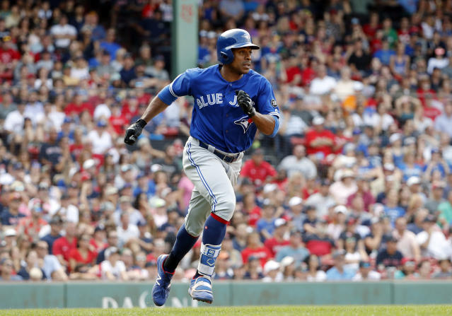 Toronto Blue Jays' Curtis Granderson runs out a hit against the Boston Red Sox in a baseball game Saturday, July 14, 2018, in Boston. (AP Photo/Winslow Townson)