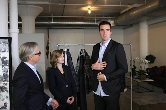 NEW YORK, NY - FEBRUARY 07: (L - R) Tommy Hilfiger, Baltimore Ravens Quarterback Joe Flacco (R) and wife Dana Flacco get ready for Fashion Week at Hudson Studios on February 7, 2013 in New York City. (Photo by Bennett Raglin/Getty Images for Tommy Hilfiger)