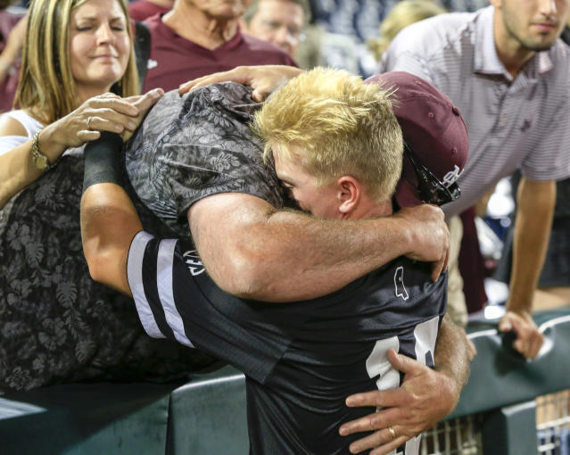 Mississippi State second baseman Hunter Stovall hugs his father, Eric, following the team's 5-2 loss to Oregon State in an NCAA College World Series baseball elimination game in Omaha, Neb., Saturday, June 23, 2018. (AP Photo/Nati Harnik)