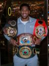 FILE PHOTO: Anthony Joshua poses with the IBF, WBA, WBO & IBO World Heavyweight belts after winning his title fight against Andy Ruiz Jr
