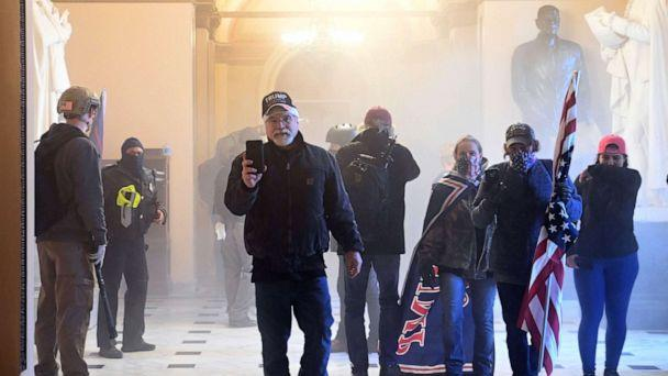 PHOTO: Supporters of President Donald Trump enter the US Capitol as tear gas fills the corridor, Jan. 6, 2021, in Washington, DC. (Saul Loeb/AFP via Getty Images)