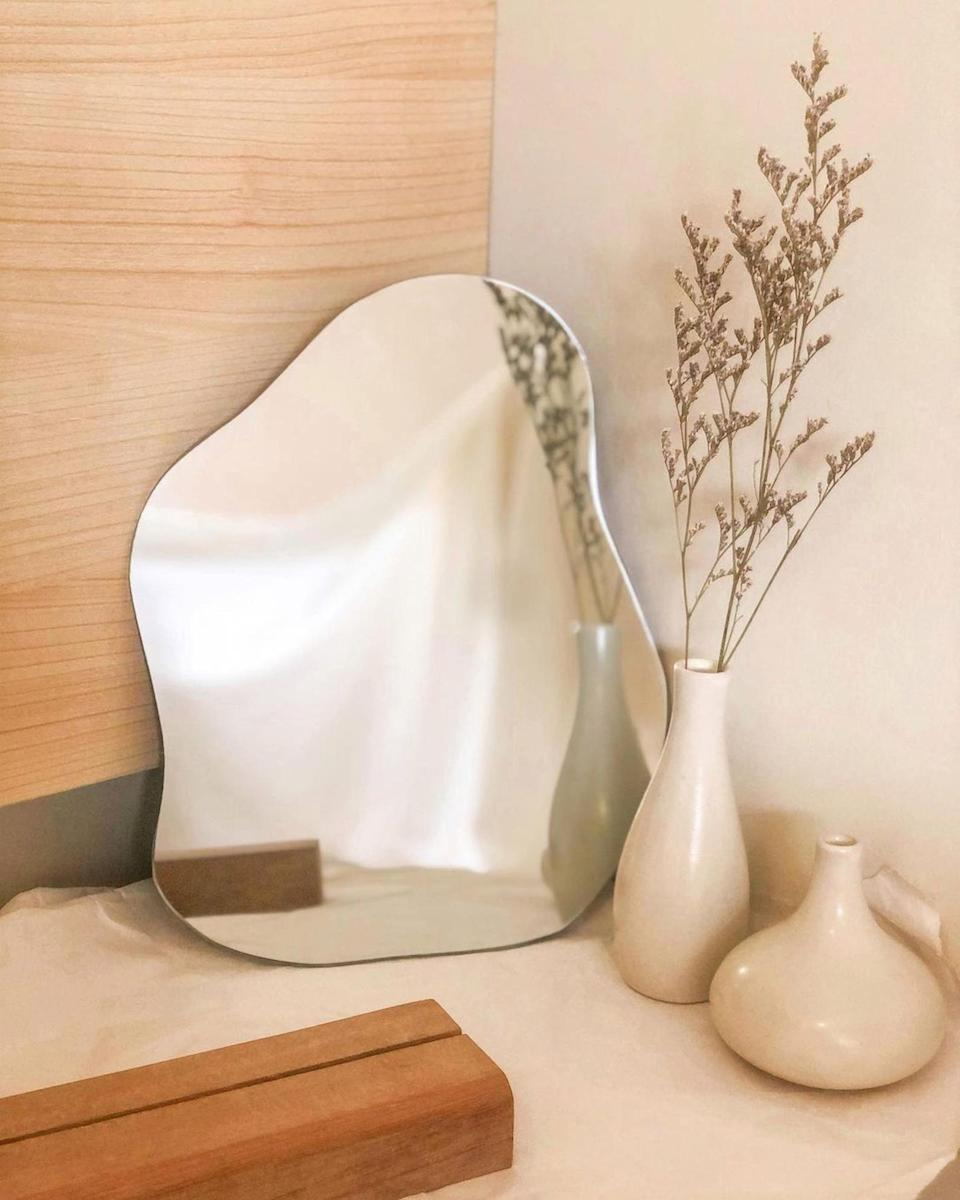 <p>This playful <span>Ecozuper Single Wave Mirror</span> ($88) comes with a wooden base, which makes it ideal for any surface - whether it's your desk, living-room shelf, or bedroom dresser.</p>