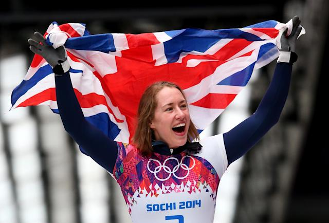 SOCHI, RUSSIA - FEBRUARY 14: Lizzy Yarnold of Great Britain celebrates winning the gold medal during the Women's Skeleton on Day 7 of the Sochi 2014 Winter Olympics at Sliding Center Sanki on February 14, 2014 in Sochi, Russia. (Photo by Julian Finney/Getty Images)
