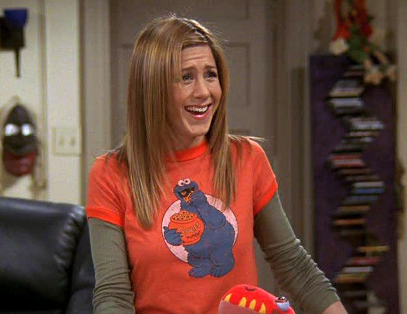 <p>Rachel Green, played by Jennifer Aniston, stole our hearts on <em>Friends,</em> a show many fans are begging to come back. Rachel often wore relatable, youthful looks that you probably already own, like this layered Cookie Monster ensemble. </p>