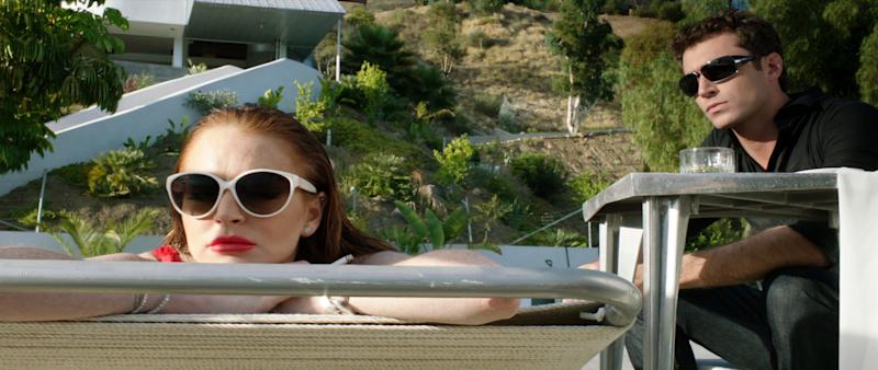 """This film image released by IFC Films shows Lindsay Lohan, left, and James Deen in a scene from """"The Canyons."""" (AP Photo/IFC Films)"""