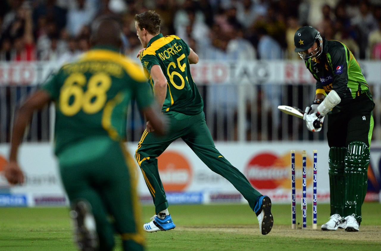 South African bowler Morne Morkel (C) celebrates after winning the first after winning the first one-day match against Pakistan in Sharjah Cricket Stadium in Sharjah on October 30, 2013. South African captain AB de Villiers won the toss and decided to bat in the first of five one-day internationals against Pakistan in Sharjah. AFP PHOTO/ Asif HASSAN        (Photo credit should read ASIF HASSAN/AFP/Getty Images)