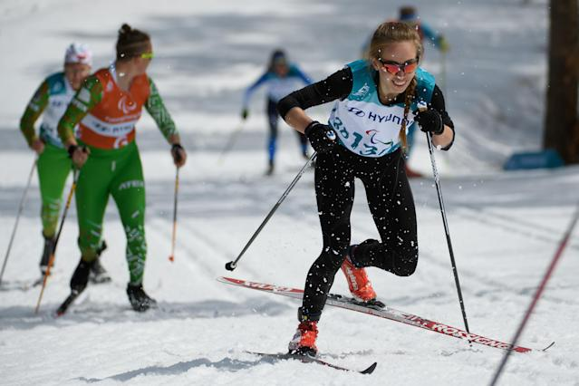 Mikhalina Lysova, a Paralympic Athlete from Russia, and her guide Alexey Ivanov compete during the Cross Country Skiing Women's Visually Impaired 7.5km Classic at the Alpensia Biathlon Centre. The Paralympic Winter Games, PyeongChang, South Korea, Saturday 17th March 2018. OIS/IOC/Thomas Lovelock/Handout via Reuters
