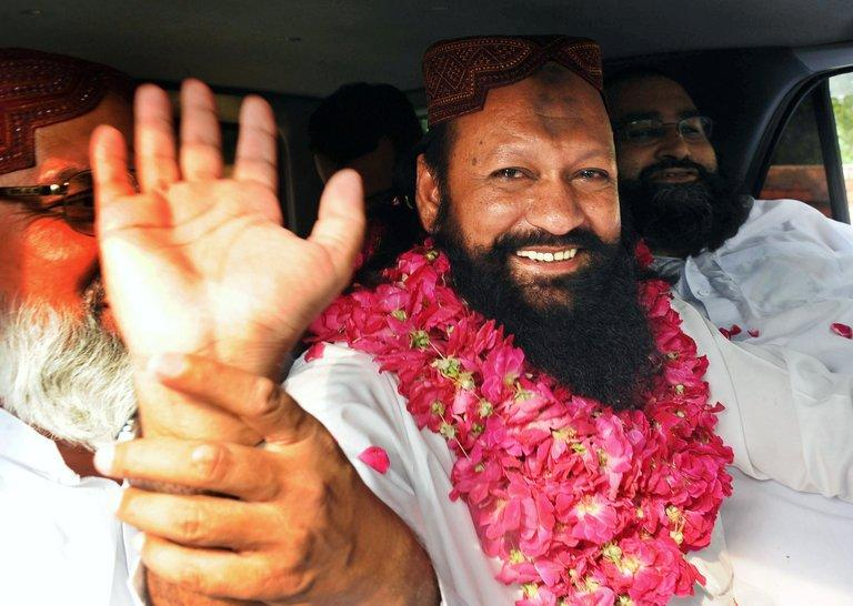Malik Ishaq waves to supporters on July 14, 2011 in Lahore as he is released on bail after nearly 14 years in prison