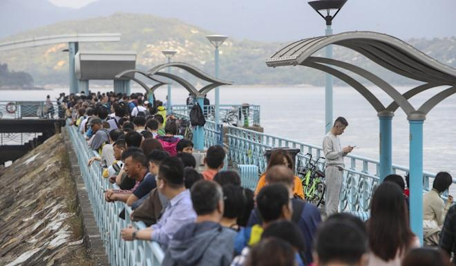 People wait for the free ferry service between Wu Kai Sha Public Pier and Tai Po Waterfront Park Pier. Photo: Winson Wong
